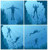 Scuba divers under water Stock Photo