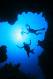 Scuba Diving. Scuba Divers descend into an Underwater Canyon royalty free stock photos