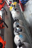 Scuba diving air tanks. A view of a row of metal scuba diving air tanks royalty free stock photo