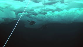 Scuba diving in Arctic at geographic North Pole. stock footage