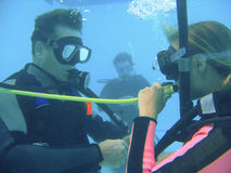Scuba diving class. Two scuba divers have an underwater adventure while learning to dive under water stock photos