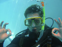 Scuba diving class. A scuba diver has an underwater adventure while learning to dive under water stock photos