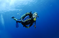 Scuba diving in clear blue water Stock Photos