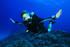 Scuba diving on coral reef Royalty Free Stock Photography