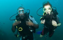 Scuba diving couple Stock Photo