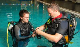 Scuba diving course pool teenager girl with instructor in the water Stock Photos