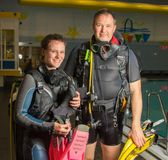 Scuba diving course pool teenager girl with instructor  on the waterfront for. Scuba diving course pool teenager girl with instructor do exercises  on the Royalty Free Stock Photo