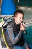 Scuba diving course pool teenager girl with instructor Stock Photo