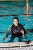 Scuba diving course pool teenager girl with instructor in the pool. Scuba diving course pool teenager girl scuba diving course pool teenager  is underwater Stock Photo
