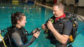 Scuba diving course pool teenager girl with instructor in the water Royalty Free Stock Photography