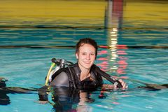 Scuba diving course pool teenager girl with instructor in the pool. Scuba diving course pool teenager girl scuba diving course pool teenager  is underwater Royalty Free Stock Image