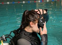 Scuba diving course pool teenager girl with instructor in the pool. Scuba diving course pool teenager girl scuba diving course pool teenager  is underwater Royalty Free Stock Images