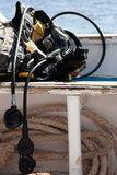 Scuba diving equipment. A scuba diving buoancy control device (BCD) with regulator on a boat, with the sea in the background Royalty Free Stock Photo