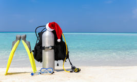 Scuba diving equipment with Santa Claus hat stock photography