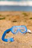 Scuba diving equipment on the yellow sea sand beach. Stock Images