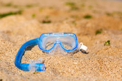 Scuba diving equipment on the yellow sea sand beach. Royalty Free Stock Photography