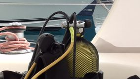Scuba-diving equipment zoom out. Scuba apparatus on-board, zoom out stock video footage
