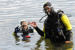 Scuba diving. Father and son ready for scuba diving royalty free stock photo