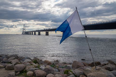Scuba diving flag in front of bridge Royalty Free Stock Photos
