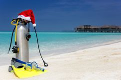 Scuba diving gear with a christmas hat on a beach stock images