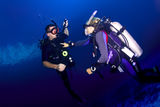 Scuba diving instructor and student stock image