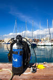 Scuba diving preparations in a marine, solving issues with moorings and ropes underwater. Marine and the sailors life in a harbour Royalty Free Stock Photos