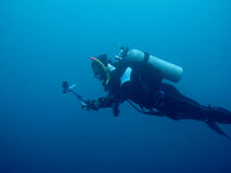Scuba diving in shipwreck royalty free stock photography