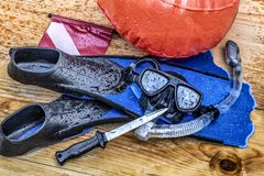 Scuba, diving, snorkeling with swimming fins, diving mask, snorkel, signal flask and knife. Are the basic equipment for safe diving Stock Photography