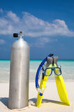 Scuba diving tank with Fins and mask on beach Royalty Free Stock Images