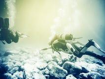 Scuba diving. Vintage effect. Stock Photo