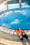 Scuba on the edge of outdoor pool Royalty Free Stock Photography