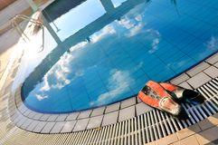 Scuba on the edge of outdoor pool Stock Image