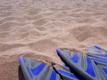 Scuba fins on beach Royalty Free Stock Images
