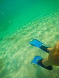 Scuba fins underwater in Sardinia Royalty Free Stock Photography