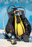 Scuba Gear. A set of Scuba gear set up by the side of a swimming pool Stock Photos