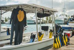 Scuba Gear and Boat at the Dock Stock Photography