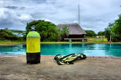 Scuba gear next to outdoor training pool Stock Photography