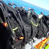 Scuba Gear Prepared for a Dive on a Boat royalty free stock photos