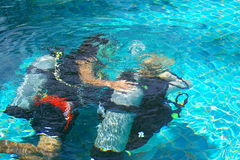 Scuba lesson. Being taught in a swimming pool Stock Images