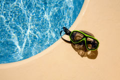Scuba mask at the poolside Stock Images