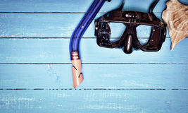 Scuba mask and snorkel on a blue wooden background Stock Photography