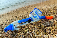 Scuba mask and snorkel. On the rocky shore of the pond royalty free stock photography