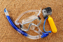 Scuba mask and snorkel on the sand. Stock Photos