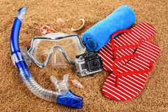 Scuba mask and snorkel on the sand. Action camera. Stock Photos