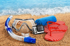 Scuba mask and snorkel on the sand. Action camera. Stock Images