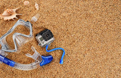 Scuba mask and snorkel on the sand. Action camera. Royalty Free Stock Photos