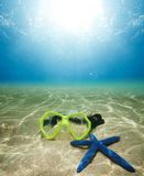 Scuba mask and starfish Royalty Free Stock Photography