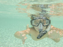 Scuba and snorkel. A young boy snorkeling for the first time Stock Photo