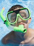 Scuba Steve. Boy in swimming pool wearing a mask and snorkel with a goofy expression Royalty Free Stock Photos