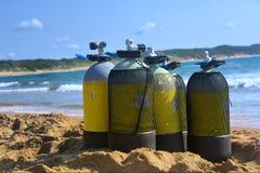 Scuba tanks on beach Royalty Free Stock Photo